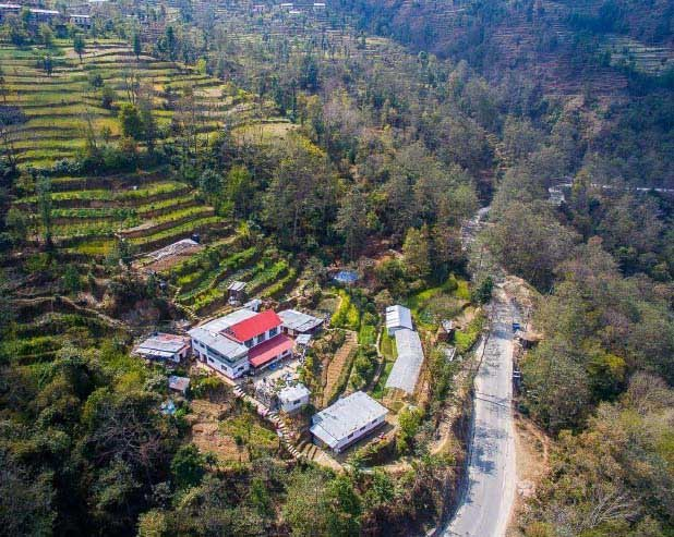 Aerial view of the farm. The farm on the sits at an altitude of 1400m the sea level and faces the Himalayas.